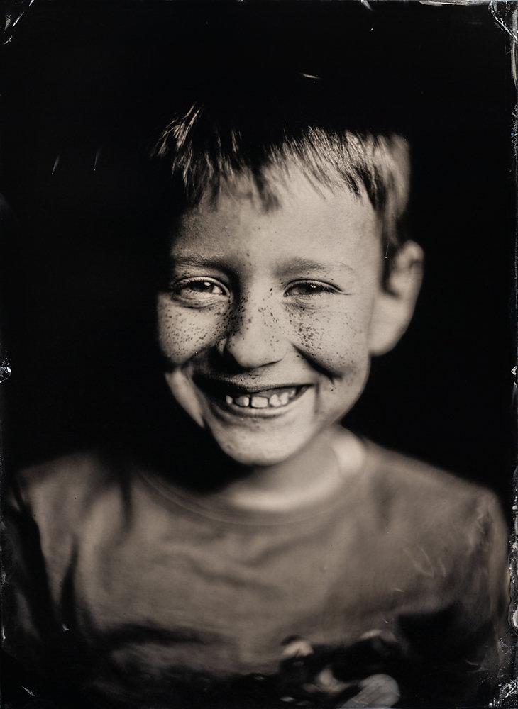 Lachendes Kind - Porträt - Photo+Adventure
